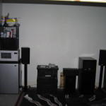 The front of my room. Fridge, nuker, subwoofer and speakers. Projector image goes in the middle.